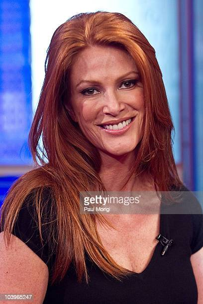 "Angie Everhart poses for a photo while on the set of ""FOX & Friends"" at the FOX studios on September 10, 2010 in New York City."