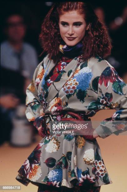 Angie Everhart walks the runway at the Kenzo Ready to Wear Fall/Winter 19911992 fashion show during the Paris Fashion Week in March 1991 in Paris...