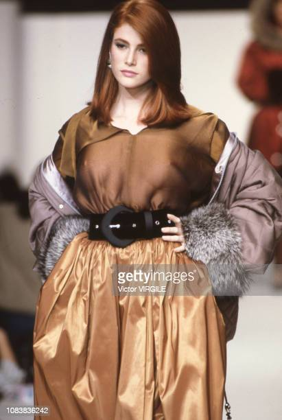 Angie Everhart walks the runway at the Olivier Lapidus Ready to Wear Fall/Winter 19911992 fashion show during the Paris Fashion Week in March 1991 in...
