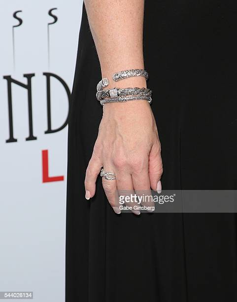 Angie Fiore bracelets ring details attends the world premiere of Criss Angel Mindfreak Live at the Luxor Hotel and Casino on June 30 2016 in Las...