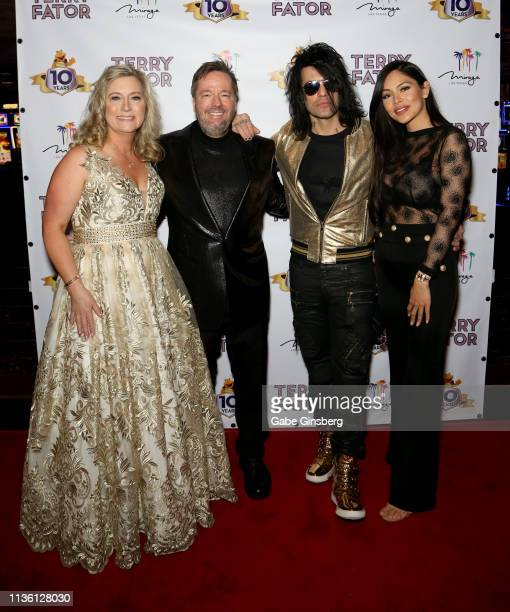 Angie Fiore Fator and her husband comic ventriloquist and impressionist Terry Fator illusionist Criss Angel and Shaunyl Benson attend Terry Fator's...