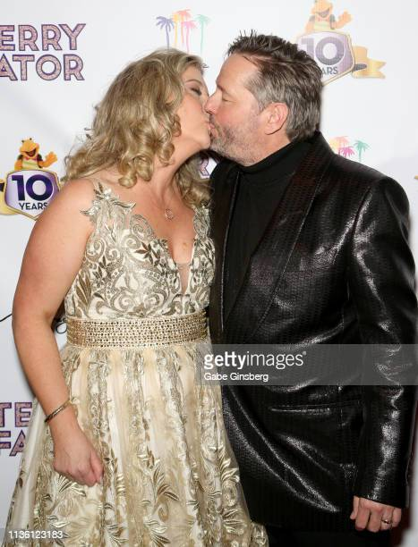 Angie Fiore Fator kisses her husband comic ventriloquist and impressionist Terry Fator during his 10th anniversary show at The Mirage Hotel Casino on...