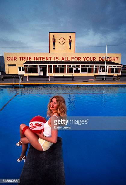 Angie from Huntingdon winner of the Lovely Legs competion in front of the swimming pool in Butlins holiday camp Skegness The slogan 'Our true intent...