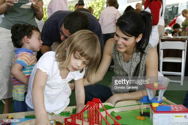 Angie Harmon and daughter during 5th Annual John Varvatos Stuart House Benefit Presented by Converse at John Varvatos Boutique in Los Angeles...