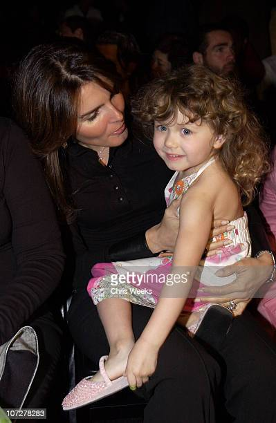 Angie Harmon and guest during Mercedes-Benz Fall 2004 Fashion Week at Smashbox Studios - Enyce and Lady Enyce - Front Row and Backstage at Smashbox...