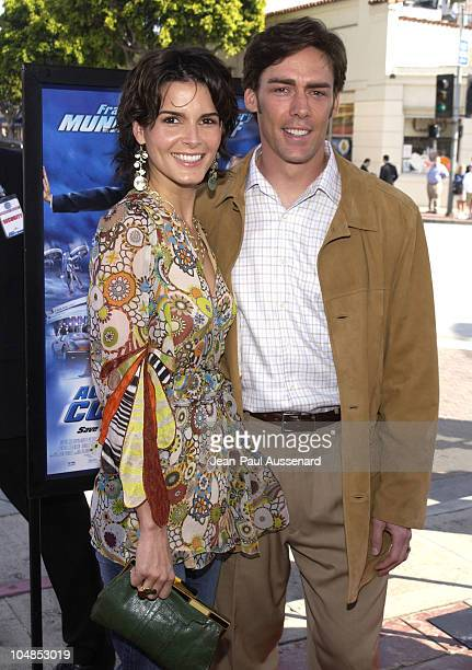 Angie Harmon and Jason Sehorn during Agent Cody Banks World Premiere at Mann Village Theater in Westwood California United States