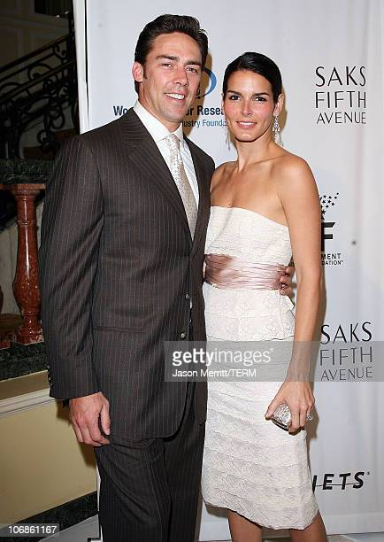 Angie Harmon and Jason Sehorn during Saks Fifth Avenue's Unforgettable Evening Benefit for EIF's Women's Cancer Research Fund Arrivals at Regent...