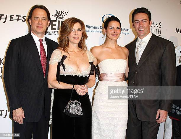 Angie Harmon and Jason Sehorn with Tom Hanks and Rita Wilson