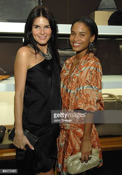 Angie Harmon and Joy Bryant at the Vogue and Step Up Women's Network fashion event at Bally on October 28 2008 in Beverly Hills California