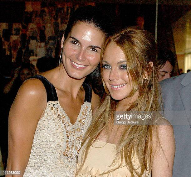 Angie Harmon and Lindsay Lohan during Prada Celebrates the Los Angeles Opening of 'Waist Down Skirts By Miuccia Prada' at Prada in Hollywood...