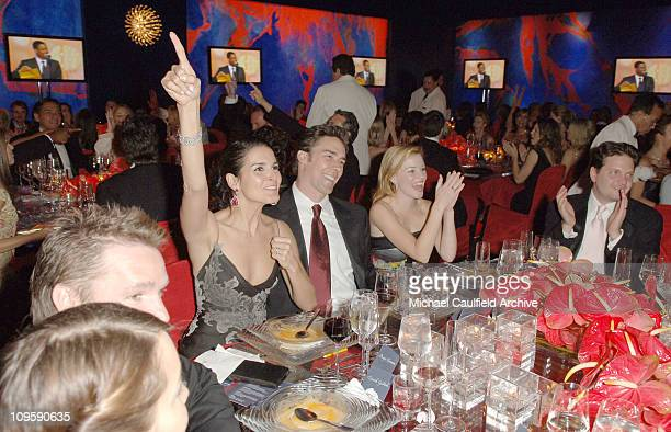 Angie Harmon, Jason Sehorn and Elizabeth Banks during InStyle & Warner Bros. 2006 Golden Globes After Party - Inside at Beverly Hilton in Beverly...