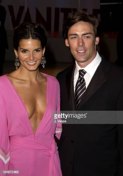 Angie Harmon Jason Sehorn during 2002 Vanity Fair Oscar Party Hosted by Graydon Carter Arrivals at Morton's Restaurant in Beverly Hills California...