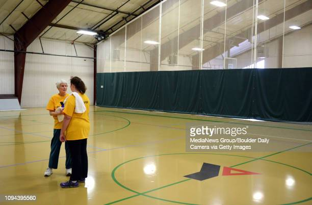 Angie Holdaway left and Angela Larson talk after an exercise class for cancer survivors Tuesday afternoon Feb 12 2013 at the Ed and Ruth Lehman YMCA...
