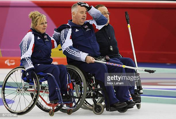 Angie Malone commiserates with Great Britian team mate Frank Duffy after the Wheelchair Curling Final between Great Britain and Canada during Day...