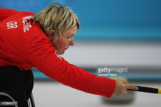 Angie Malone of Great Britain plays a shot during the bronze medal match between China and Great Britain on day eight of Sochi 2014 Paralympic Winter...