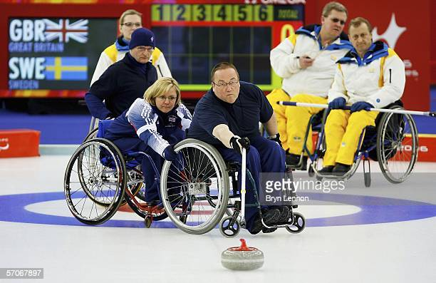 Angie Malone of Great Britain team mate Tom Killin as he releases the stone during Wheelchair Curling match between Great Britain and Sweden on day...