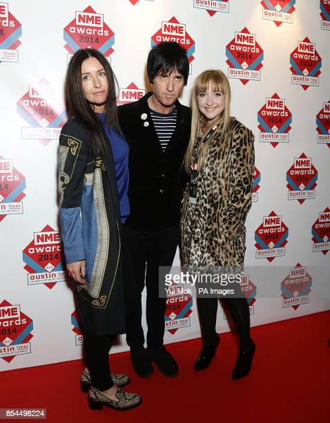 Angie Marr Johnnie Marr and Sonny Marr arriving for the 2014 NME Awards at Brixton Academy London