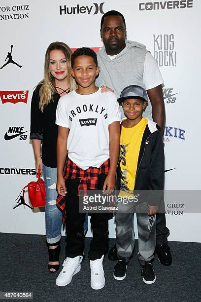 Angie Martinez and her son Nico pose with Oronde Garrett and his son Christan backstage at the Kids Rock fashion show during Spring 2016 New York...