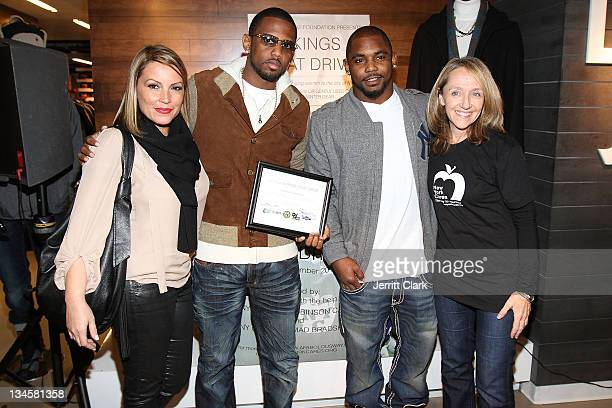 Angie Matinez Fabolous Ahmad Bradshaw and Colleen Farrell of NY Cares attend the 2011 3 Kings Coat drive at Dr Jay's on December 1 2011 in New York...