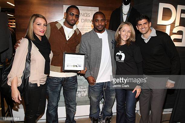Angie Matinez Fabolous Ahmad Bradshaw Colleen Farrell of NY Cares and Joe Betesh Owner of DR Jays attend the 2011 3 Kings Coat drive at Dr Jay's on...