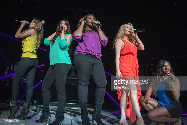 Angie Miller Kree Harrison Candice Glover Janelle Arthur and Amber Holcomb perform during American Idol Live 2013 at Nassau Veterans Memorial...