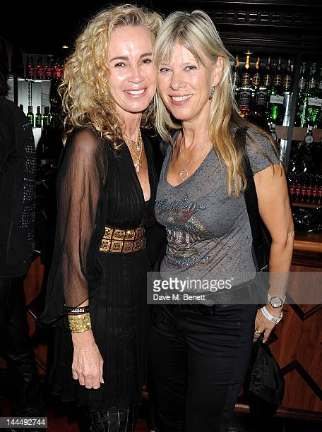 Angie Rutherford and Annette Mason celebrate backstage after the We Will Rock You 10 Year Anniversary performance at The Dominion Theatre on May 14...