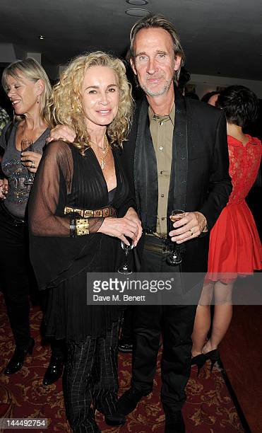 Angie Rutherford and Mike Rutherford celebrate backstage after the We Will Rock You 10 Year Anniversary performance at The Dominion Theatre on May 14...