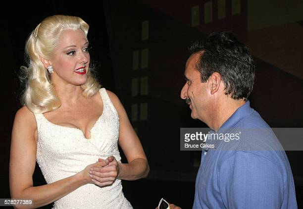 Angie Schworer and Charles Camarda during NASA Discovery STS114 Astronauts Visit Broadway's The Producers Backstage at St James Theater in New York...