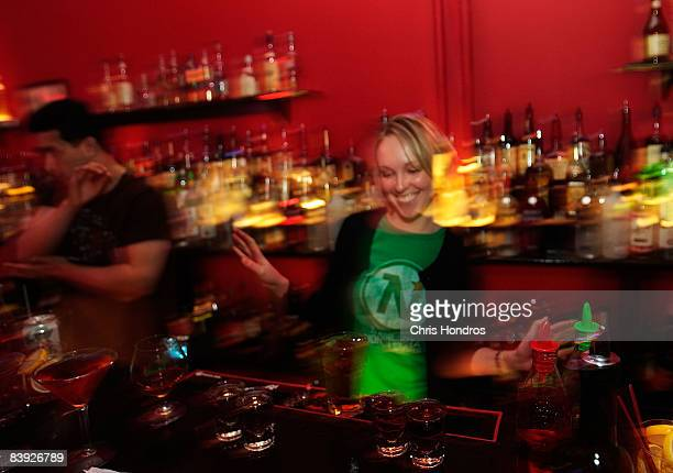 Angie Seigley celebrates after passing her New York Bartending School final exam December 5 2008 in New York City Seigley formerly worked at Morgan...