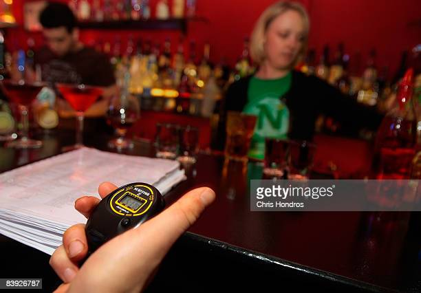 Angie Seigley is timed as she takes her New York Bartending School final exam December 5 2008 in New York City Seigley formerly worked at Morgan...