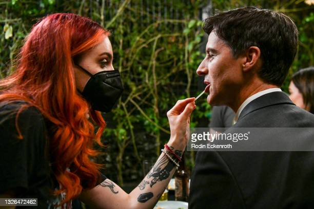 """Angie Shell touches up actor Charlie Farrell's makeup during production of the indie feature film, """"The Star City Murders"""" on July 01, 2021 in Los..."""