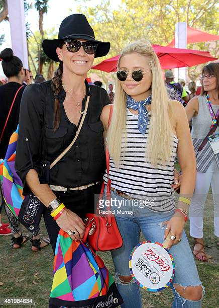 Angie Simpson and Alli Simpson arrive to cheer on Cody Simpson Bree Bogucki Madison Tevlin and Marc Roberge of OAR as they open the 2015 Los Angeles...