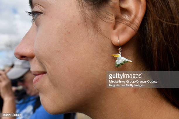 Angie Trumbo a development and programs assistant with International Bird Rescue dons pelican earrings as they release an American White Pelican at...