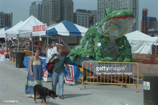 Angie Van Horn 19 and Karla Kiepzman both of Minneapolis walk Dylan the dog thru the River Feast area on the new bridge