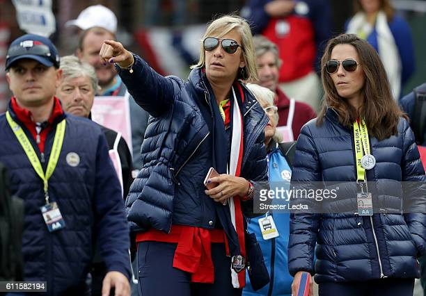 Angie Watson and Sybi Kuchar look on during morning foursome matches of the 2016 Ryder Cup at Hazeltine National Golf Club on September 30 2016 in...