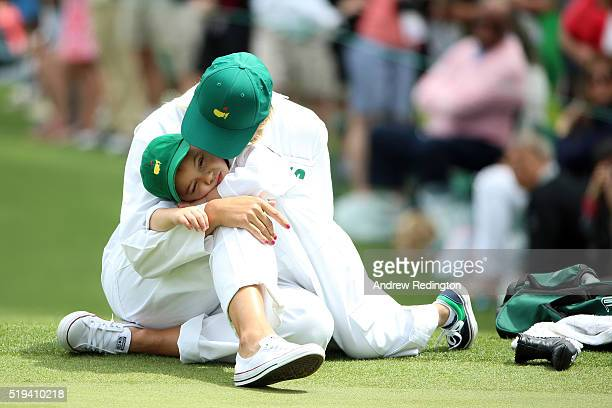 Angie Watson holds her son Caleb during the Par 3 Contest prior to the start of the of the 2016 Masters Tournament at Augusta National Golf Club on...