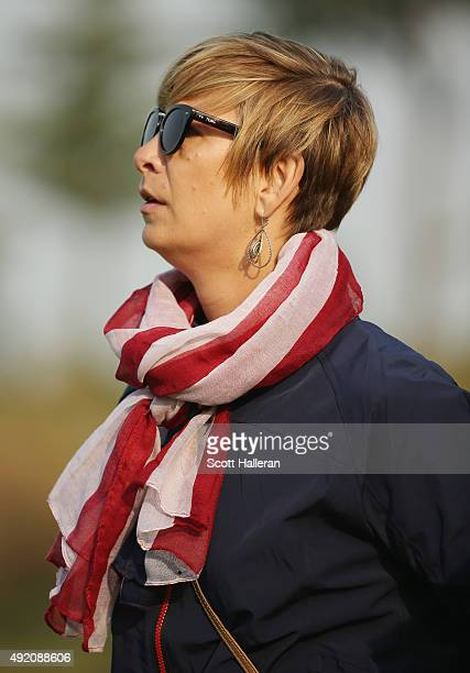 Angie Watson of the United States Team watches the play during the Saturday foursomes matches at The Presidents Cup at Jack Nicklaus Golf Club Korea...
