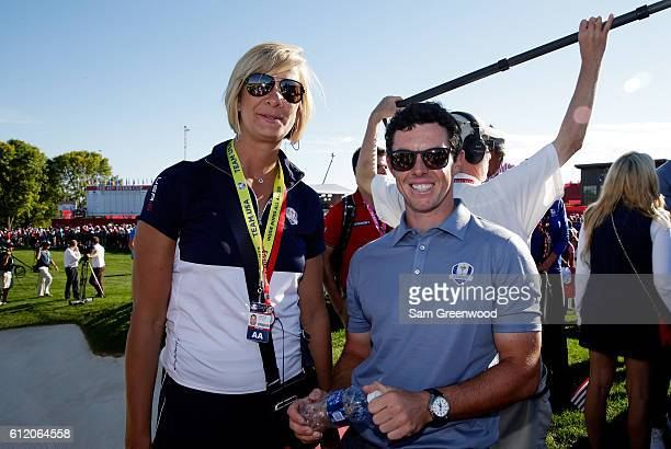 Angie Watson poses with Rory McIlroy of Europe after the United States defeated Europe to win the Ryder Cup during singles matches of the 2016 Ryder...