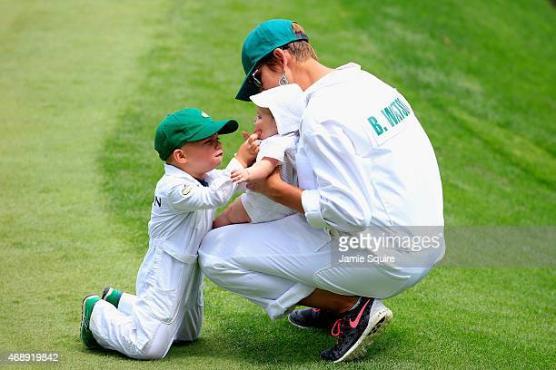 Angie Watson waits with her son Caleb and daughter Dakota during the Par 3 Contest prior to the start of the 2015 Masters Tournament at Augusta...