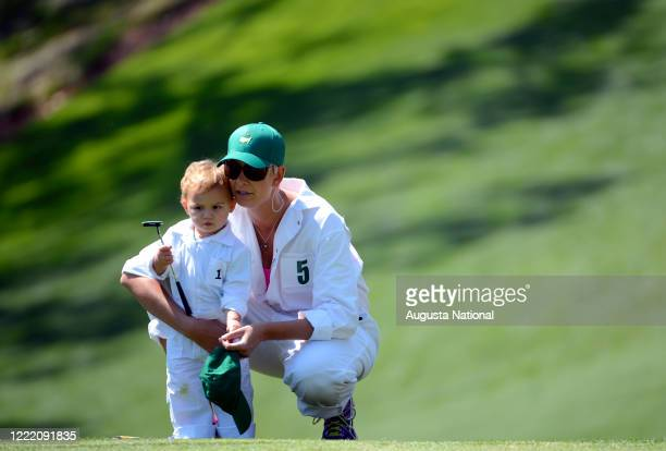Angie Watson wife of Maters champion Bubba Watson with their son Caleb on No 1 green during the Par 3 Contest at Augusta National Golf Club on...