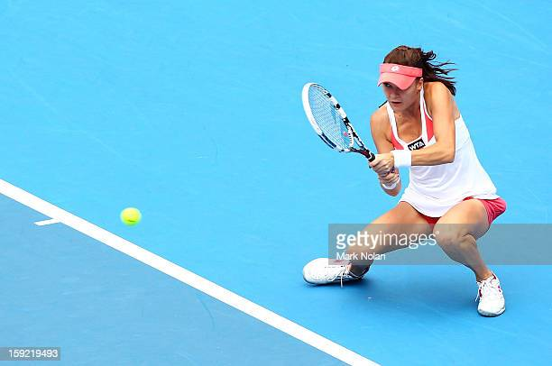 Angieszka Radwanska of Poland plays a backhand in her semi final match against Na Li of China during day five of the Sydney International at Sydney...