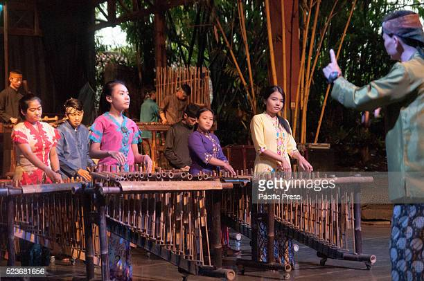 Angklung performers in Saung Udjo This Sundanese traditional bamboo instrument also play modern pop music to entertaint visitor