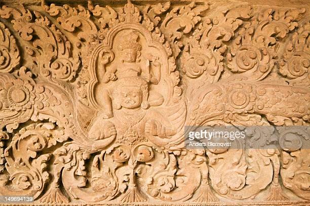 Angkor era Hindu statue of Vishnu riding on Garuda in the National Museum.