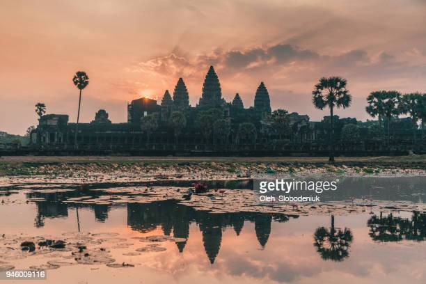 angkor wat at sunrise - angkor stock photos and pictures