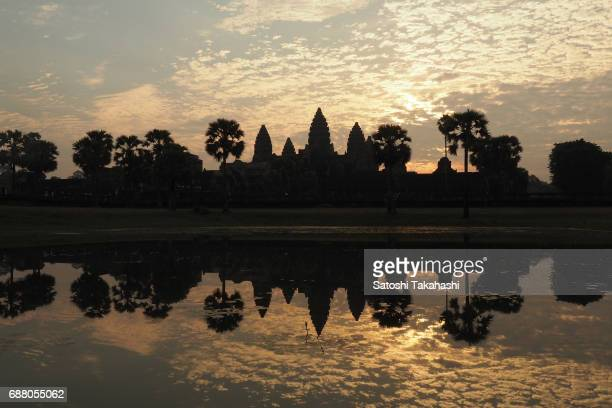 Angkor Wat at sunrise The temple was built by the King Suryavarman II in the early 12th century in the capital of the Khmer Empire
