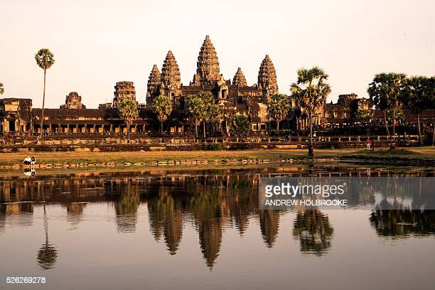 Angkor Wat at sunset reflected in the water Angkor Watis a UNESCO World Heritage site and the largest religious monument in the world It was...