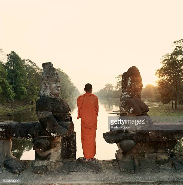 Angkor Wat, Buddhist monk on bridge at sunrise