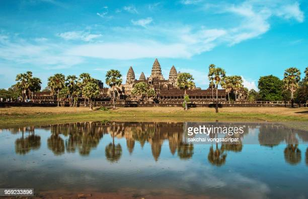 Angkor Wat Temple Against Sky During Sunset, Reflected in The Water, Siem Reap, Cambodia