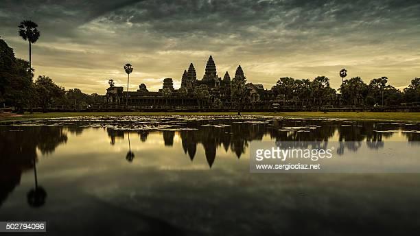 Angkor Wat temple at dawn reflected in water