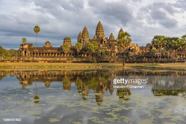 Angkor Wat temple at sunset, with reflection in lake, Siem Reap, Cambodia